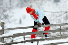 Young woman jumping over fence Stock Photography