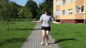 Young woman jumping rope stock footage