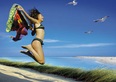 Young woman jumping by sea Royalty Free Stock Photo
