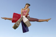 Young Woman Jumping With Shopping Bags Stock Images