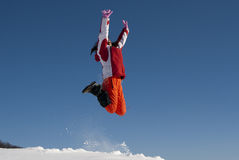 Young woman jumping in snow Royalty Free Stock Image