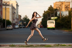 Young woman jumping at the street in city Royalty Free Stock Photography