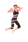 Young woman jumping from the tape. Royalty Free Stock Image