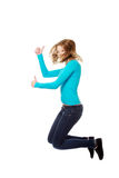 Young woman jumping with thumbs up. Teenage woman jumping showing thumbs up Stock Photo