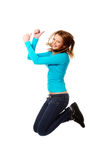 Young woman jumping with thumbs up. Teenage woman jumping showing thumbs up Royalty Free Stock Photos