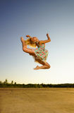 Young woman jumping. Young women jumping in the evening time Stock Images