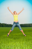 Young woman jumps Royalty Free Stock Image