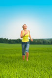 Young woman jumps Royalty Free Stock Photography