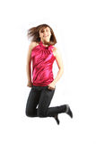 Young woman jumps up to throw us back-legs Royalty Free Stock Photography