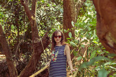 Young woman in the jungle on the bridge in tropical spice planta Royalty Free Stock Photos