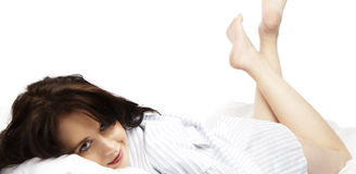 Young woman just awakening in bed Royalty Free Stock Photography