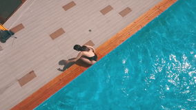 A young woman just out of the pool stock video