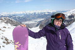 Young woman on the Kaprun, skiing resort in Austria. Royalty Free Stock Image