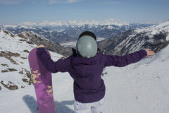 Young woman on the Kaprun, skiing resort in Austria. A view from the back. Stock Photography