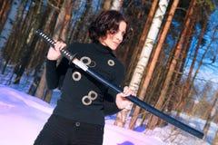 Young woman with a katana Royalty Free Stock Image