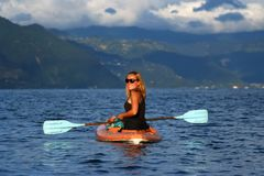 Young woman in the kayak Stock Images