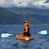 Young woman in the kayak Royalty Free Stock Photos