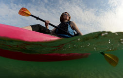 Young woman in kayak on ocean Stock Photo