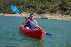 Young woman with a kayak Stock Photo