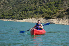 Young woman with a kayak Stock Photography