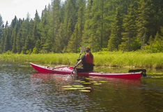 Young woman in kayak on a pond royalty free stock photography