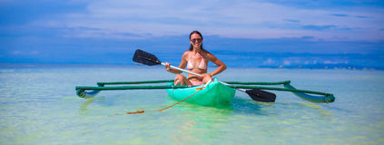 Young woman kayaking alone in the clear blue sea Royalty Free Stock Photo