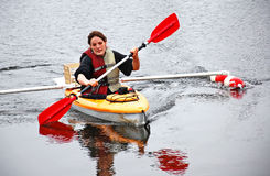 Young Woman Kayaking in Colder Weather Stock Photo
