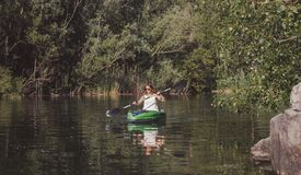 Young woman kayaking on the lake stock images