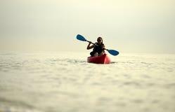 Young woman kayaking Stock Photos