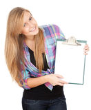 Young woman keeping blank clipboard Royalty Free Stock Image