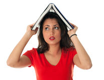Young woman keeping book on her head Royalty Free Stock Images