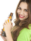 Young woman keeping brown bottle of beer Stock Images