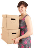 Young woman keeping cardboard boxes Stock Photos