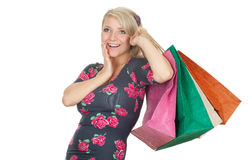 Young woman keeping coloured shopping bags Stock Photos