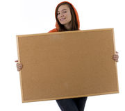 Young woman keeping cork board Royalty Free Stock Images