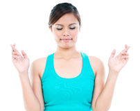 Young Woman Keeping Fingers Crossed Royalty Free Stock Photos