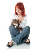 Young woman keeping grey cat Stock Image
