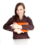 Young woman keeping orange box Stock Photo