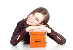 Young woman keeping orange box Royalty Free Stock Images