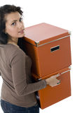 Young woman  keeping orange cardboard boxes Stock Photography
