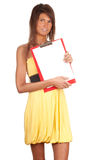Young woman keeping red clipboard Stock Image