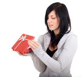 Young woman keeping red present box Royalty Free Stock Image