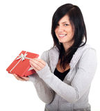 Young woman keeping red present box Stock Photos