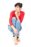 Young woman keeping silent, full length Stock Photography