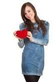 Young woman keeping small red heart Stock Image