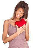 Young woman keeping small red heart Royalty Free Stock Photography