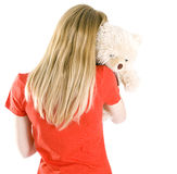 Young woman keeping Teddy bear Stock Photography