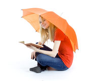 Young woman keeping umbrella and book Royalty Free Stock Image