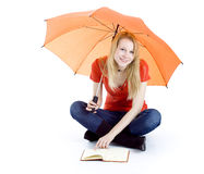 Young woman keeping umbrella and book Stock Photos