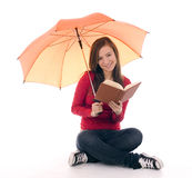 Young woman keeping umbrella and book Stock Photography